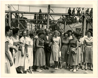 Adlai Stevenson poses for photograph with 16 women at Bellingham industrial site
