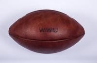 """Football: Wilson NCAA football (back side, with """"WWU"""" stamped into leather), undated"""