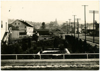 Manicured gardens of Pacific American Fisheries facilities with Harris Avenue on right, extending eastward with Fairhaven Hotel in distance