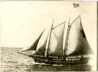 """Blanket Bill"" Jarman's four-masted schooner with American flag on the water"