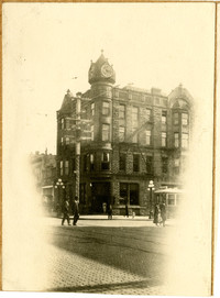 Exterior of National Bank in Bellingham - large brick building at street corner with turret-like corner and clock tower