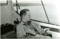 Man seated in boat fishing in Bellingham Bay