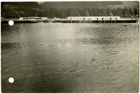 Waters of Excursion Inlet, Alaska, with docks and warehouses in background