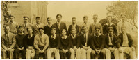 Fairhaven High School boys and teacher pose outside school