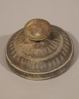 Waisted lidded vessel with two rows of four rectangular slots in stem: lid