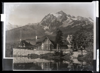 Mt. Baker Lodge with Mt. Shuksan looming in the background and a lake in the foreground reflecting the Lodge