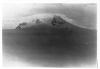 skiiers with unidentified mountain range