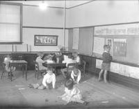 1929 First Grade Class Planning Its Garden