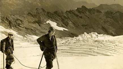 Sepia toned photo of two mountaineers in a snowy field